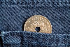 Denmark coin denomination is two krone crown in the pocket of blue denim jeans. Denmark coin denomination is 2 krone crown in the pocket of blue denim jeans Stock Photography
