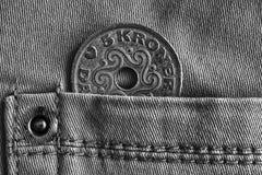 Denmark coin denomination is 5 krone crown in the pocket of denim jeans, monochrome shot. Denmark coin denomination is five krone crown in the pocket of denim Stock Images