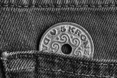 Denmark coin denomination is 5 krone crown in the pocket of denim jeans, monochrome shot. Denmark coin denomination is five krone crown in the pocket of denim Stock Photos