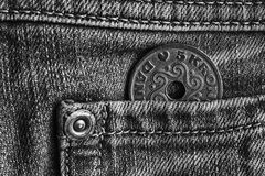 Denmark coin denomination is five krone crown in the pocket of light denim jeans, monochrome shot. Denmark coin denomination is 5 krone crown in the pocket of Royalty Free Stock Image