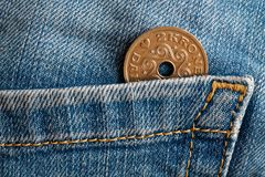 Denmark coin denomination is two krone crown in the pocket of old blue worn denim jeans. Denmark coin denomination is 2 krone crown in the pocket of old blue Royalty Free Stock Photography