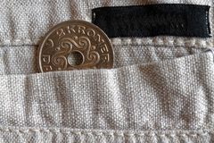 Denmark coin denomination is 2 krone (crown) in the pocket of old linen pants with black stripe. Denmark coin denomination is two krone (crown) in the pocket of Royalty Free Stock Photos