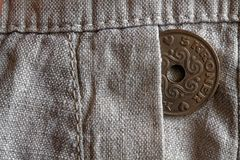 Denmark coin denomination is 5 krone (crown) in the pocket of old linen pants. Denmark coin denomination is five krone (crown) in the pocket of old linen pants Stock Image