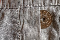 Denmark coin denomination is 2 krone crown in the pocket of old linen pants. Denmark coin denomination is two krone crown in the pocket of old linen pants Royalty Free Stock Photography