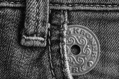 Denmark coin denomination is 5 krone crown in the pocket of old worn denim jeans, monochrome shot. Denmark coin denomination is five krone crown in the pocket of Royalty Free Stock Images