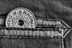 Denmark coin denomination is five krone crown in the pocket of worn denim jeans with stripe, monochrome shot. Denmark coin denomination is 5 krone crown in the Royalty Free Stock Photo