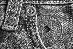 Denmark coin denomination is 5 krone crown in the pocket of worn light denim jeans, monochrome shot. Denmark coin denomination is five krone crown in the pocket Royalty Free Stock Photo