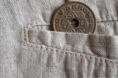 Denmark coin denomination is 5 krone (crown) in the pocket of worn linen pants. Denmark coin denomination is five krone (crown) in the pocket of worn linen pants Stock Photography