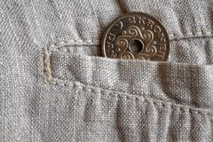 Denmark coin denomination is 2 krone crown in the pocket of worn linen pants. Denmark coin denomination is two krone crown in the pocket of worn linen pants Royalty Free Stock Photography