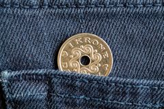 Denmark coin denomination is one krone crown in the pocket of blue denim jeans.  Royalty Free Stock Image