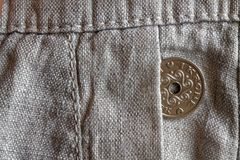 Denmark coin denomination is 1 krone (crown) in the pocket of old linen pants. Denmark coin denomination is one krone (crown) in the pocket of old linen pants Royalty Free Stock Photography