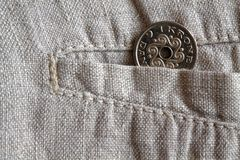 Denmark coin denomination is 1 krone (crown) in the pocket of worn linen pants. Denmark coin denomination is one krone (crown) in the pocket of worn linen pants Stock Image
