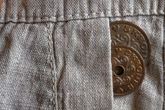 Denmark coin denomination is 2 and 5 krone (crown) in the pocket of old linen pants. Denmark coin denomination is two and five krone (crown) in the pocket of old Royalty Free Stock Image
