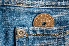 Denmark coin denomination is two krone crown in the pocket of light blue denim jeans. Denmark coin denomination is 2 krone crown in the pocket of light blue Royalty Free Stock Images