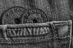 Denmark coins denomination is five and two krone crown in the pocket of worn denim jeans with stripe, monochrome shot. Denmark coins denomination is 5 and 2 Royalty Free Stock Photos