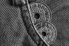Denmark coins denomination is 5 and 2 krone crown in the pocket of old denim jeans, monochrome shot. Denmark coins denomination is 5 and two krone crown in the Stock Images