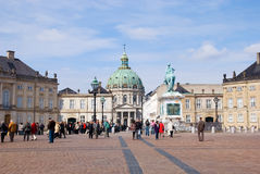 Denmark. Copenhagen. Amalienborg Palace. COPENHAGEN, DENMARK - APRIL 13, 2010: Visitors near Amalienborg Palace. It is a residence of Royal Family of Denmark. In Royalty Free Stock Image