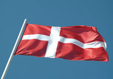 Denmark or danish flag. Waving on blue sky Stock Photo