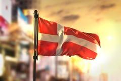 Denmark Flag Against City Blurred Background At Sunrise Backligh Royalty Free Stock Photo