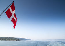 Denmark flag from the back of a boat leaving copenhagen Stock Photography