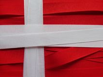 Denmark flag or banner. Made with red and white ribbons Stock Photo