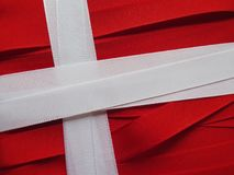 Denmark flag or banner. Made with red and white ribbons royalty free stock images
