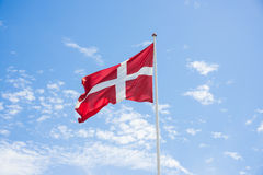 Denmark Flag. With blue sky background royalty free stock photography