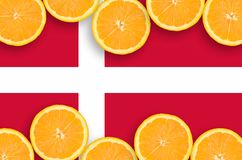 Denmark flag in citrus fruit slices horizontal frame. Denmark flag in horizontal frame of orange citrus fruit slices. Concept of growing as well as import and stock illustration