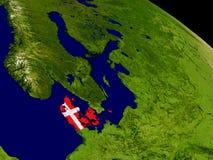 Denmark with flag on Earth Royalty Free Stock Photos