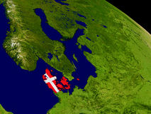 Denmark with flag on Earth Royalty Free Stock Photo