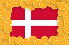 Denmark flag in fresh citrus fruit slices frame. Denmark flag in frame of orange citrus fruit slices. Concept of growing as well as import and export of citrus stock illustration