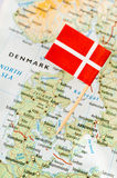 Denmark flag on map. Denmark paper flag pin on a map royalty free stock photos