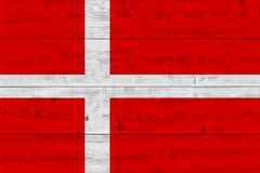 Denmark flag painted on old wood plank. Patriotic background. National flag of Denmark royalty free stock photo