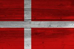 Denmark flag painted on old wood plank. Patriotic background. National flag of Denmark royalty free stock photos