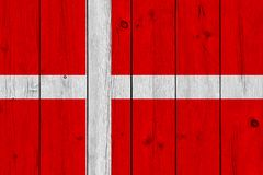 Denmark flag painted on old wood plank. Patriotic background. National flag of Denmark stock photos