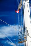 Denmark flag on ship mast, blue sky in background. Denmark flag on ship sail boat mast with blue sky in background Royalty Free Stock Image