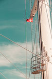 Denmark flag on ship mast, blue sky in background. Denmark flag on ship sail boat mast with blue sky in background Royalty Free Stock Images