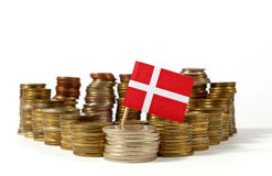 Denmark flag with stack of money coins Royalty Free Stock Photo
