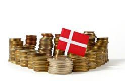 Denmark flag with stack of money coins. Denmark flag waving with stack of money coins Royalty Free Stock Photo