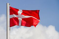 Denmark flag. Is waving in front of blue sky stock photo