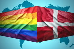 Denmark and Gay flags. Waving Danish and Gay flags of the political map of the world Royalty Free Stock Image