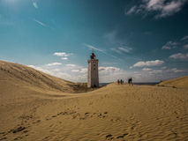 Lighthouse in Dunes. The famous lighthouse in Denmark Royalty Free Stock Image