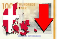 Denmark map on Danish krone money background with red arrow down Royalty Free Stock Photography