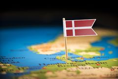 Denmark marked with a flag on the map.  royalty free stock photo