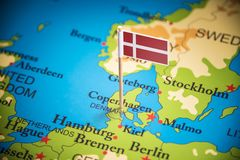 Denmark marked with a flag on the map.  stock photography