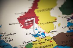 Denmark marked with a flag on the map.  royalty free stock photography