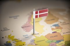 Denmark marked with a flag on the map.  stock image