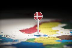 Denmark marked with a flag on the map.  royalty free stock image