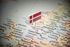 Denmark marked with a flag on the map.  stock photos