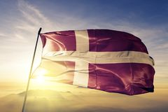 Denmark national flag textile cloth fabric waving on the top. Danish national flag textile cloth fabric waving on the top sunrise mist fog vector illustration